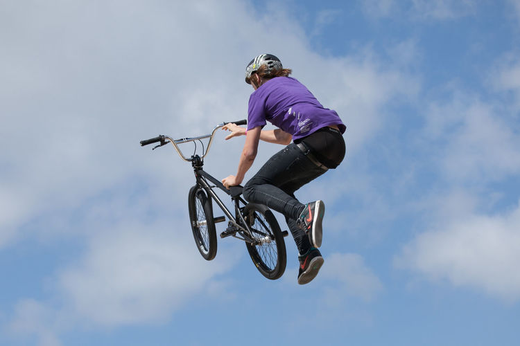 BMX stunt riders Bicycle Bike Bike Stunt Bmx  BMX Contest Bmxlife Cycle Exhilaration Extreme Sports Flight Flying Full Length Jumping Leisure Activity Lifestyles Low Angle View Mid-air Mode Of Transport On The Move Outdoors RISK Sky Stunt Transportation Young Adult