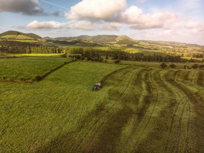 Manuring the field Manure Açores - São Miguel Azores Portugal Drone Photograph DJI X Eyeem DJI Mavic Air Farm Green Color Mountain Day Scenics - Nature Nature Rural Scene Tranquil Scene Field Beauty In Nature Land Tranquility Agriculture Plant No People Sky Environment Landscape Cloud - Sky Growth