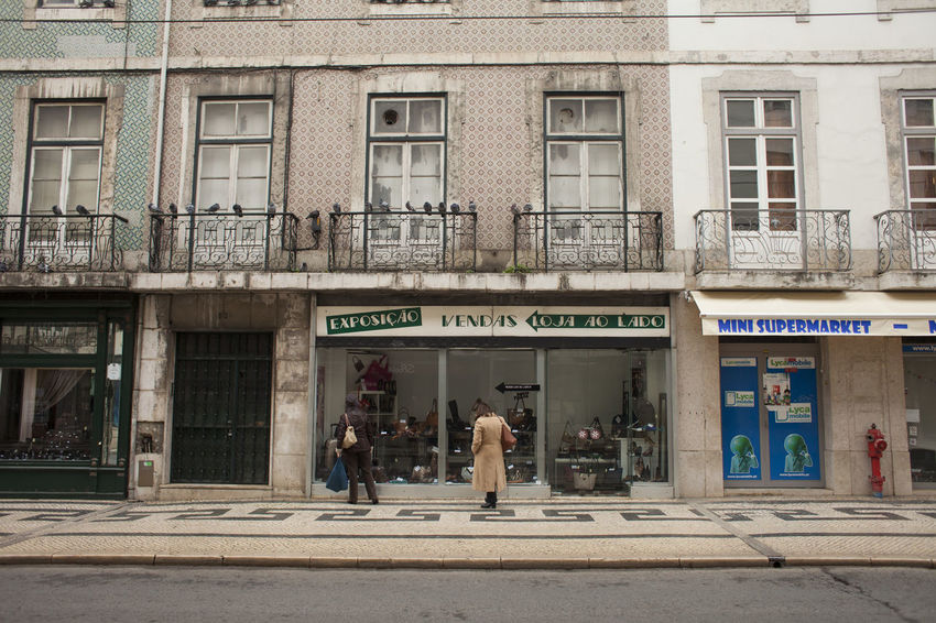 Portugal Architecture Building Building Exterior Built Structure City Entrance Façade Footpath Group Of People Lifestyles Lisbon People Real People Street Text Western Script