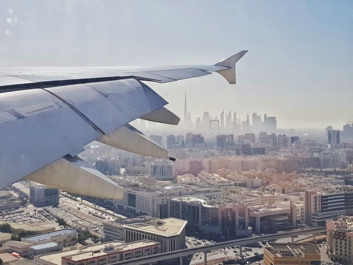 Dubai skyline from the Airplane window View From An Airplane Airplaneview Airplane Wing Traveling By Plane United Arab Emirates Dubai Architecture Cityscape Building Exterior City Day Built Structure