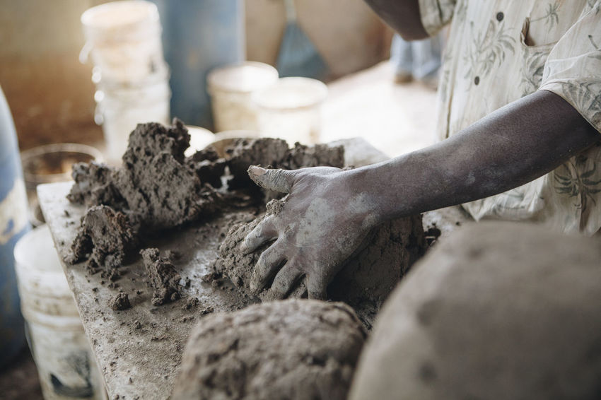 Africa African Business By Hand Ceramic Clay Clay Work Close-up Dirty Entrepreneurship Factory Filter Hand Work Hands Manufacturing Mud Pottery Production Raw Material Sculpting Social Business Table Water Filter Working Workshop