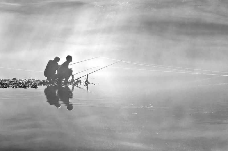 People on boat against sky