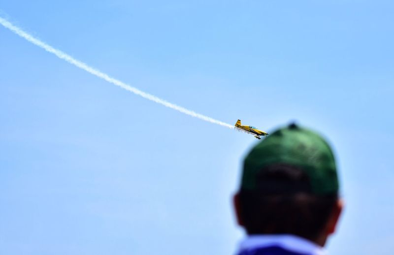 Rear View Of Man Looking At Airshow