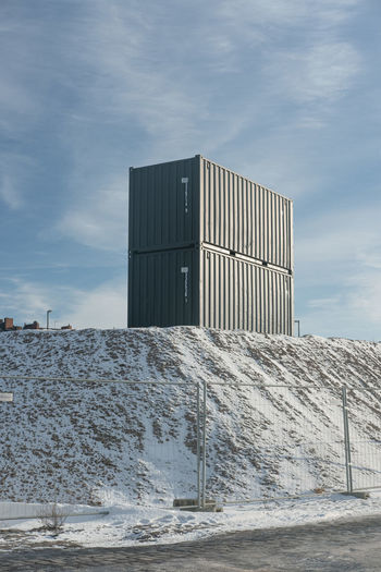 Stack of building against sky during winter