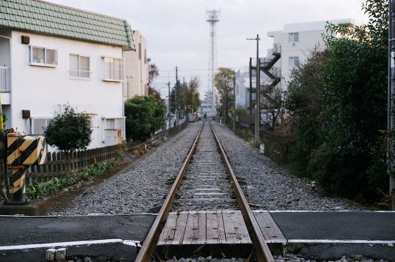 View of railway tracks along buildings