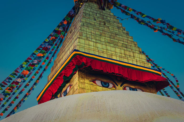 Boudhanath Stupa World Heritage Site By UNESCO Architecture Belief Building Building Exterior Built Structure Clear Sky Day Flag Low Angle View Multi Colored Nature No People Outdoors Place Of Worship Religion Sky Spirituality Travel Travel Destinations