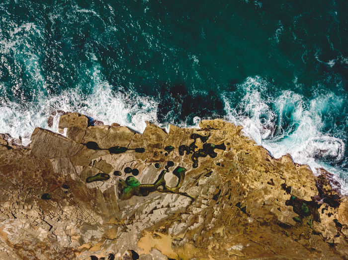 The Figure Eight Pools. Top down drone shot of the bizarre natural rock pool formations along the Royal National Park coastline. Water Sea Motion Rock Wave Rock - Object Nature Splashing No People Power In Nature Beauty In Nature Breaking Outdoors Rock Formation Land Power Figure 8 Pools Figure Eight Pools Natural Pool Rock Pool Bizarre Swimming Iconic Landmark Natural Wonder Coastal Feature Coastline Shore Rock Shelf Royal National Park Sydney Australia Drone  Drone Photography Top Down View Aerial View From Above  Dji DJI Mavic Air DJI X Eyeem Swimming Hole Top Down Abstract Nature Plateau Discover Places Travel Destination Tourism Hiking Coastline Landscape Places