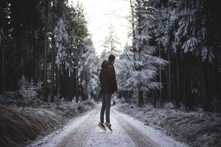 Beauty In Nature Full Length Tree One Person Forest Nature Rear View Real People Cold Temperature Day Winter Outdoors Growth The Way Forward Men Warm Clothing People