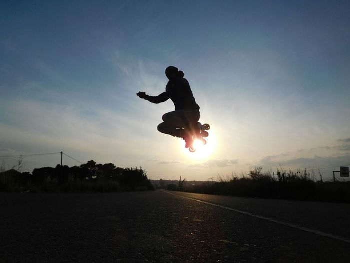 Full Length One Person Sport Skateboard Skill  Mid-air Practicing Vitality People Leisure Activity One Man Only Motion Stunt Only Men Silhouette Jumping Healthy Lifestyle Skateboard Park Outdoors Sky