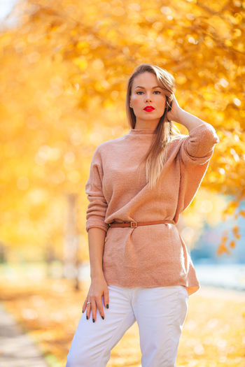 Portrait of beautiful young woman during autumn