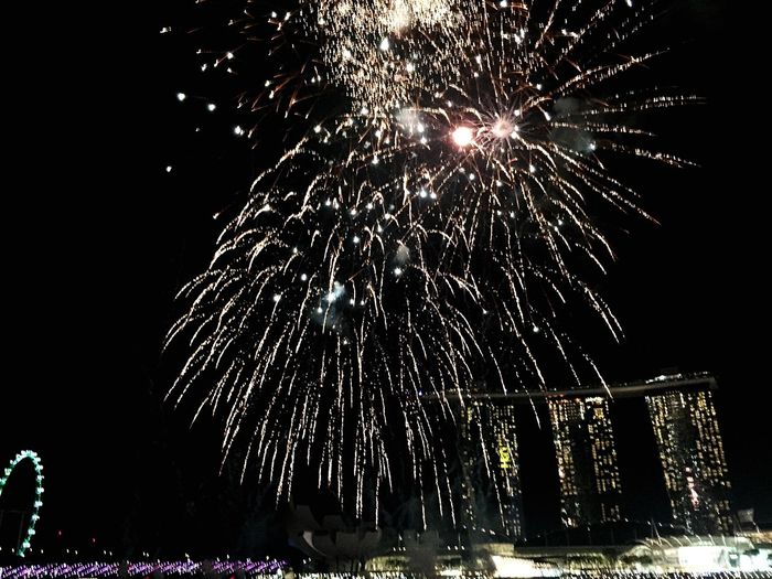 When darkness meets lights! Celebration Firework Display Firework - Man Made Object Night Exploding Low Angle View Illuminated Motion City Sparks Firework Outdoors Singapore Marina Bay Sands Welcome To Black