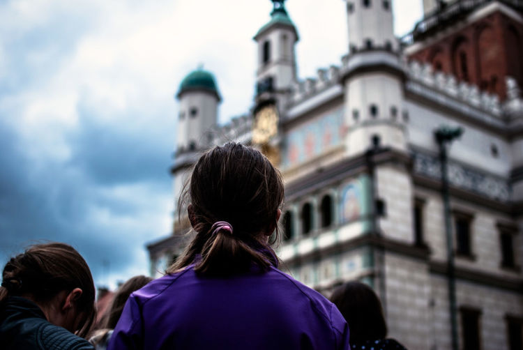 Rear View Of Woman Looking At Poznan Town Hall