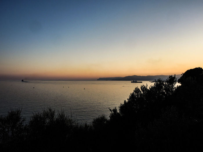 Italy 2017 Beach Beauty In Nature Clear Sky Day Horizon Over Water Landscape Nature No People Outdoors Scenics Sea Silhouette Sky Sunset Tranquil Scene Tranquility Tree Water