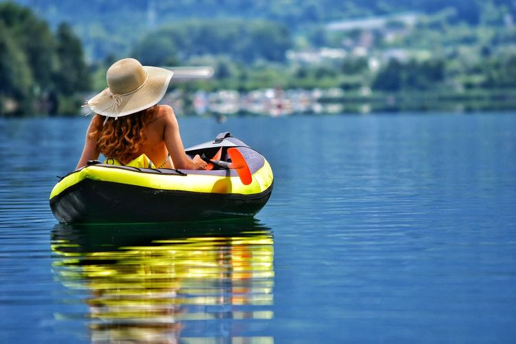 Woman sitting in boat on lake