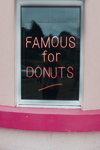 Pink neon sign ' Famous for Donuts' in Southend on Sea, Essex, United Kingdom Donuts Pink Shop Sign Sign Southend On Sea United Kingdom Architecture Beach Building Exterior Close-up Communication Day Donut Neon Neon Sign No People Open Sign Outdoors Red Text Western Script Window Windows Words