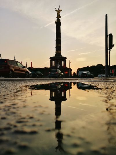 Reflexion Siegessäule  Reflection Puddle Berlin Berliner Ansichten Berlin Photography Berlin Love Germany Deutschland Travel Photography EyeEm Selects City Water Sunset Symmetry Reflection History Cityscape Sky Architecture Travel Reflecting Pool Architectural Column Historic