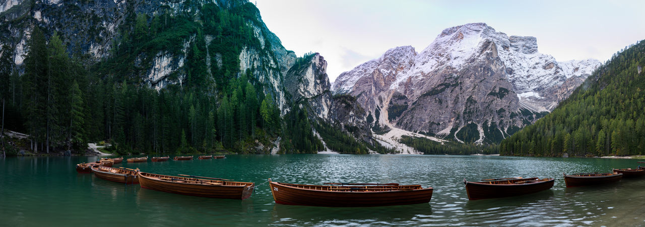 Panoramic view of boats in lake against sky