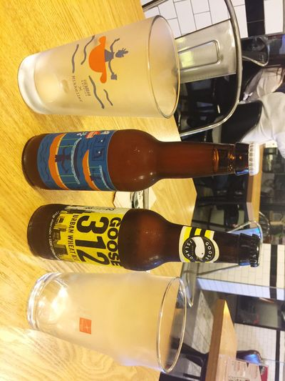 Two bottle of Imported Beer with goumet burgers.