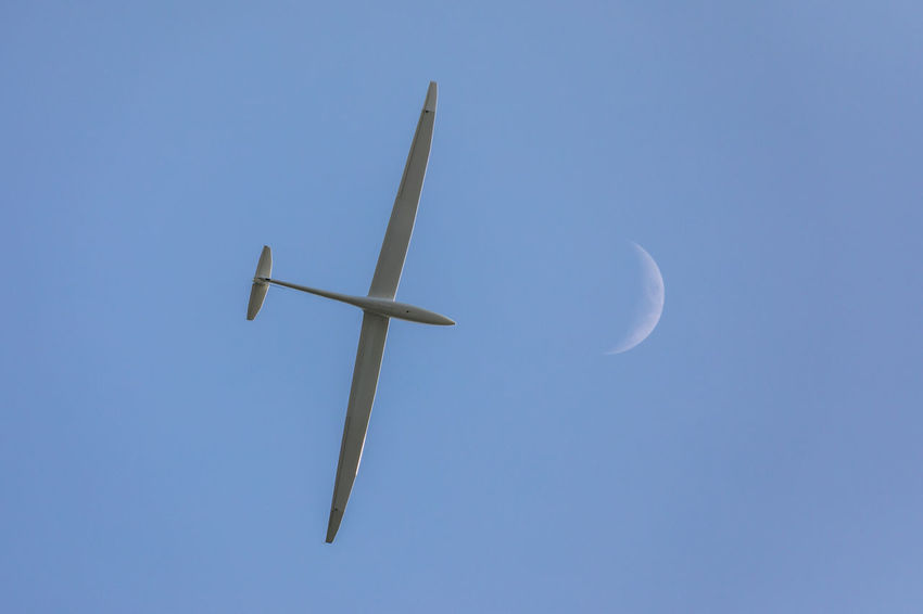 Crescent Moon Glider Aircraft High Tranquility Aircraft Airplane Beauty In Nature Blue Clear Sky Copy Space Crescent Day Flying Glider High Angle View Low Angle View Mode Of Transportation Moon Nature No People Outdoors Sailplane Silence Sky Tranquil Scene