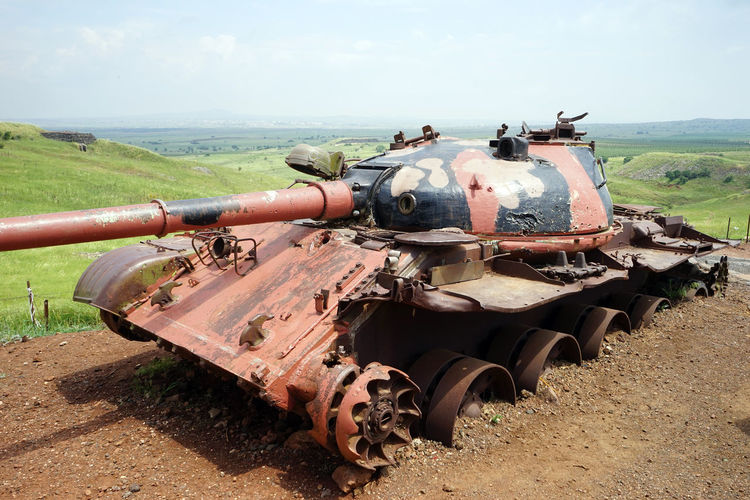 Military Day Land Weapon Nature Sky Transportation Field Tank Outdoors Metal Landscape Armored Tank Fighting Mode Of Transportation No People Environment Old Conflict Rusty Cannon Battle Explosive