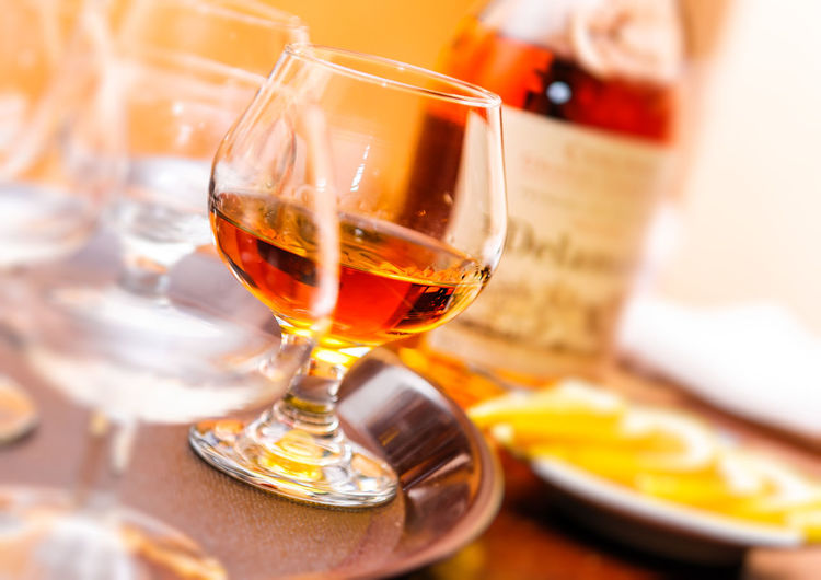 Glass of cognac Alcoholic Beverages Rum Tray Alcohol Alcohol Bottles Alcoholic  Alcoholic Drink Bar Bottle Bottle Of Cognac Brandy Close-up Cognac Cognac Glass Drink Drinking Glass Glass Of Cognac Glassware Highball Highball Glass Lemon No People Scotch Selective Focus Table