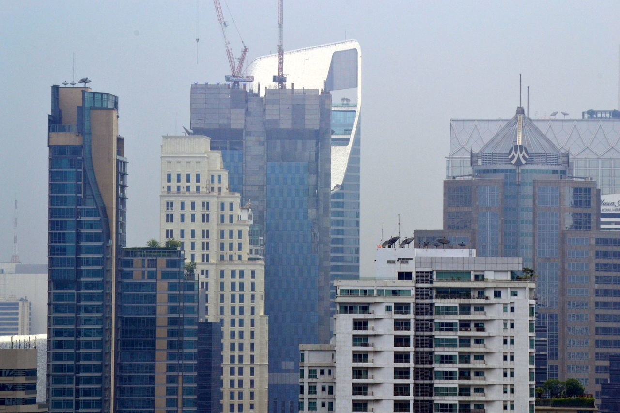 Skyscrapers In City Against Sky