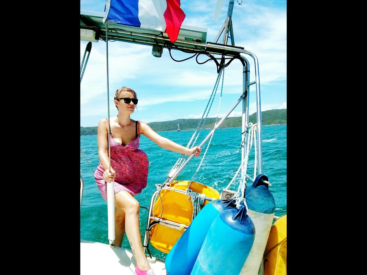 Full Length Of Young Woman On Boat At Sea