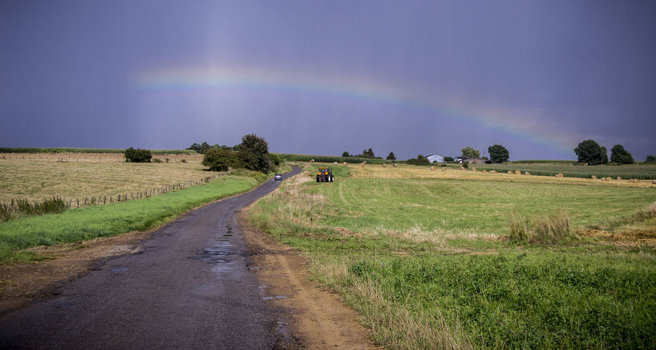 Rainbow in Wallonia Belgium Namur Beauty In Nature Day Field Grass Landscape Nature No People Outdoors Rainbow Road Rural Scene Scenics Sky The Way Forward Tranquil Scene Tranquility