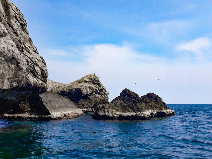 Sea of Chumphon Islands Beauty In Nature Blue Cloud - Sky Day Eroded Formation Idyllic Nature No People Non-urban Scene Outdoors Rock Rock - Object Rock Formation Scenics - Nature Sea Sky Solid Stack Rock Tranquil Scene Tranquility Water Waterfront