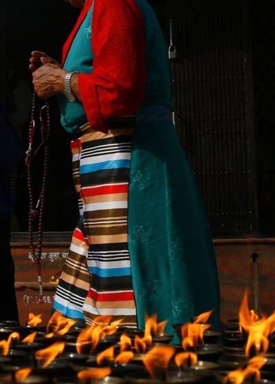 A woman worships at Bouddhanath (Kathmandu, Nepal; 2013). Bouddha  Buddhism Candles Nepal Prayer Streetphotography Temple Tibetan  Woman Worship