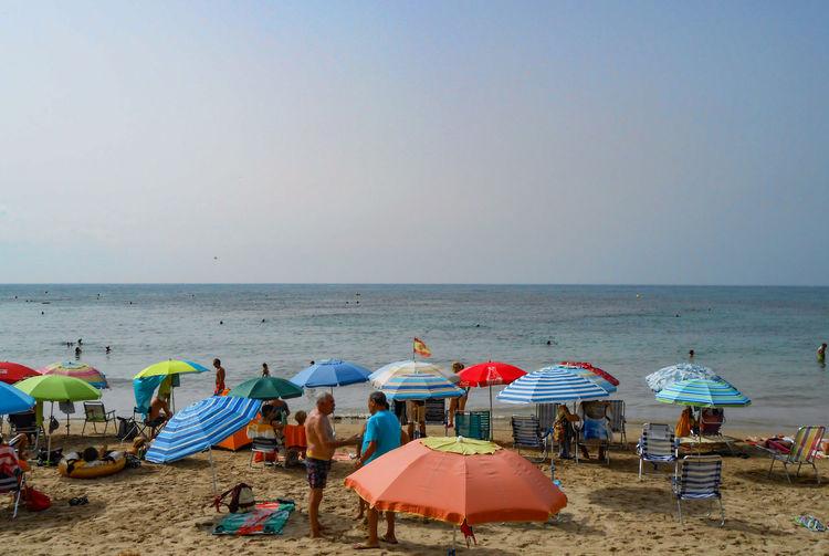 spanish beach Mediterranean  Water Sea Beach Sand Summer Relaxation Blue Canopy Beach Umbrella Parasol Sunshade Umbrella Resort Shore Shelter Surf