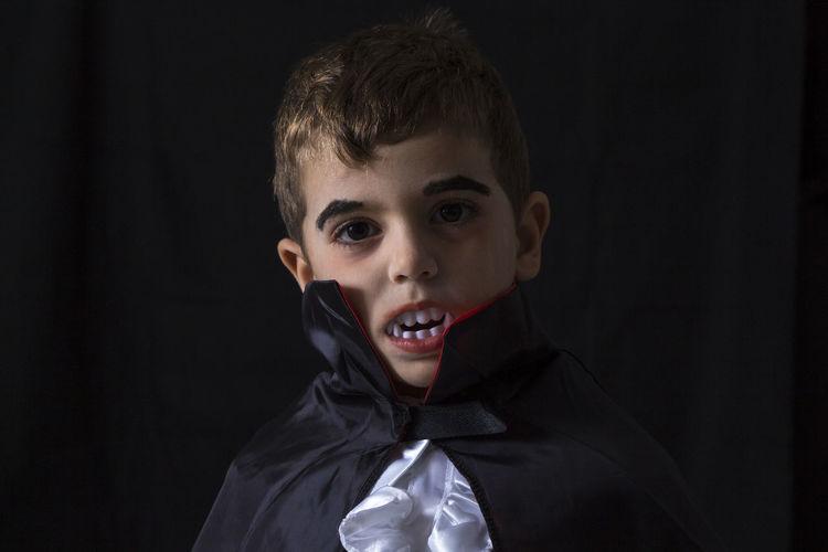 Close-up portrait of boy in vampire costume