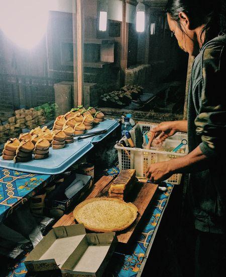 Man preparing martabak, one of indonesian food at market stall