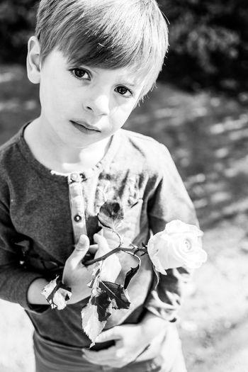 Portrait of cute boy holding baby