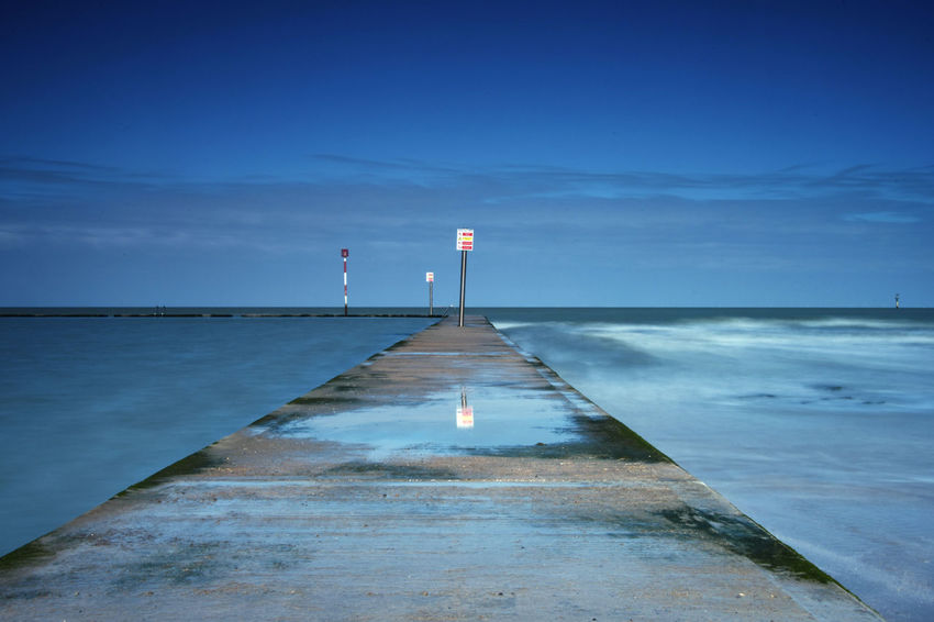 Blue Sky Calm Before The Storm Calm Water Choice Concrete Difference  Different Perspective Different Points Of View Diminishing Perspective Direction Horizon Over Water Jetty Nature Opposites Pier Scenics Sea Sign Sky The Way Forward Tranquil Scene Tranquility Vanishing Point Water Way Ahead