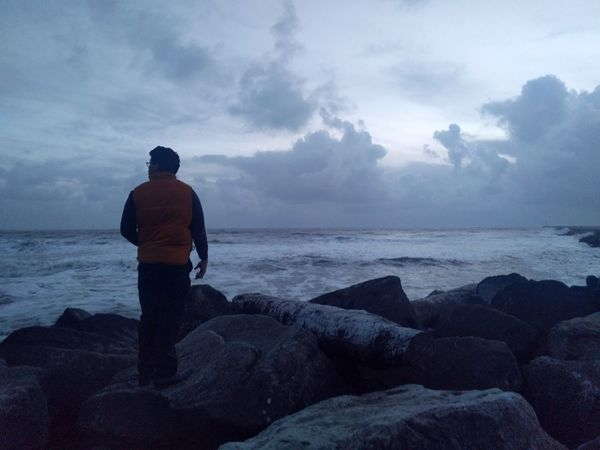Sea Rear View Beach One Person Outdoors Adult One Man Only People Men Wave Adventure Waves Storm Coastline Clouds And Sky Cold Temperature