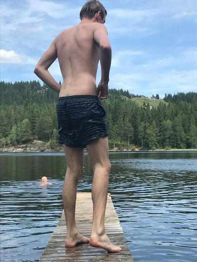 Out swimming EyeEm Selects Water Tree Shirtless Plant Lake Lifestyles Leisure Activity Rear View Men One Person Real People Standing Nature Sky Holiday Day Cloud - Sky Outdoors Vacations Shorts