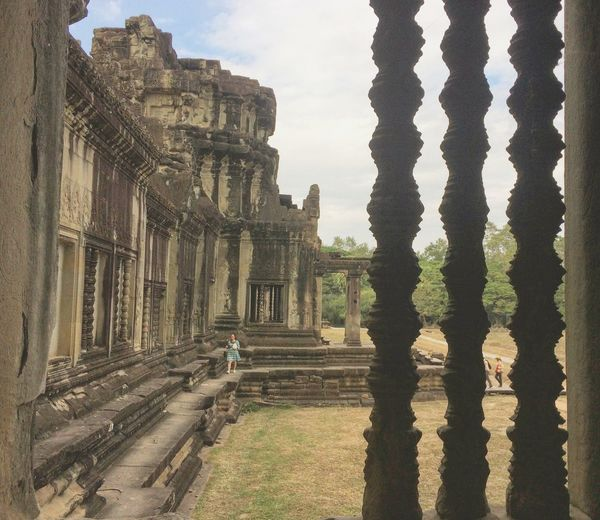 Framed Architecture Old Ruin Travel Destinations Religion Ancient Civilization Built Structure Ancient Tourism History Travel Place Of Worship Spirituality Day Building Exterior Outdoors Vacations No People Sky AngkorWatTemple Siemreap Cambodia Explorecambodia Southeastasia Indochina Landscape