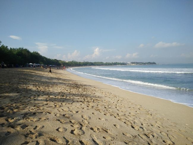 Wide view of Kuta Beach, Bali, Indonesia Beach Beauty In Nature Blue Cloud Cloud - Sky Coastline Day Horizon Over Water Idyllic Incidental People Nature Non-urban Scene Outdoors Remote Sand Scenics Sea Shore Sky Tourism Tranquil Scene Tranquility Travel Destinations Vacations Water