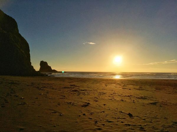 Beach Photography No People Tasman Sea Sundown West Coast New Zealand Sea Beach Sand Nature Beauty In Nature Scenics Water Tranquility Sun Sunset Sky Horizon Over Water Rock - Object Travel Destinations Tranquil Scene