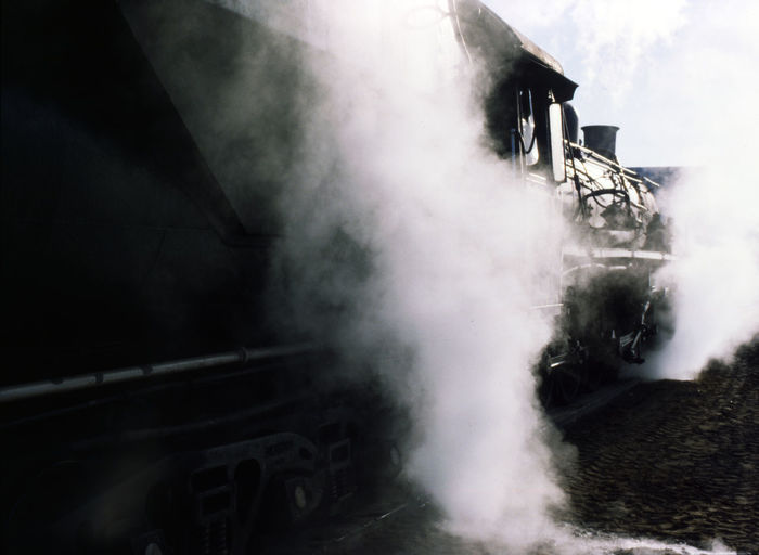 Steam locomotive in Station is waiting for departure INTERTOURIST Power Smoke Station Steam Architecture Black And White Day Land Vehicle Motion No People Outdoors Railway Station Train Steam Locomotive Steam Train Transportation