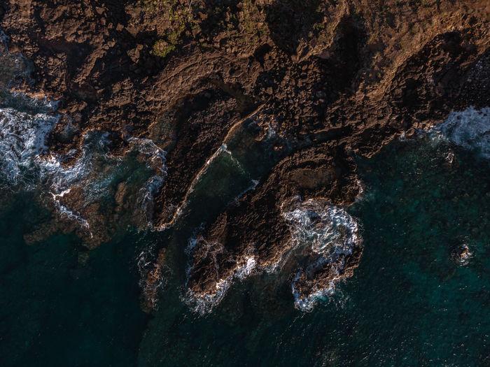 Full frame shot of rock formation in sea