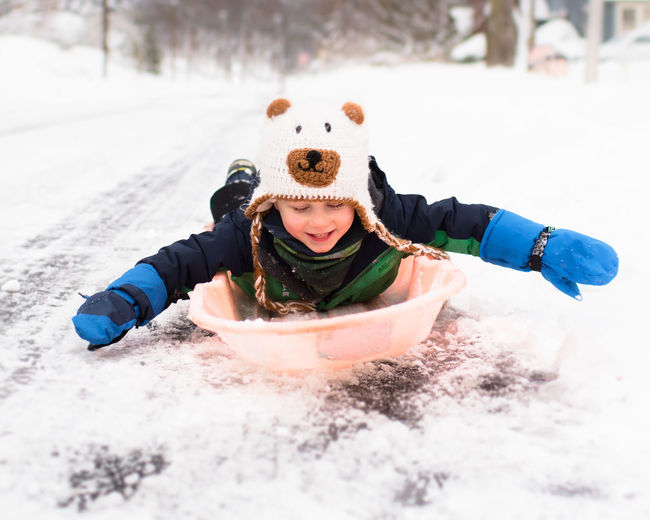 3 Years Old Happy Sled Blizzard Boys Child Childhood Cold Temperature Fun Glove Happiness Playing Sledding Smiling Snow Tobogganing Winter