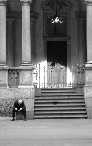 The light behind you Black & White Streetphotography One Person People Blackandwhite Blackandwhite Photography Milano Milan Architecture Reading People Photography