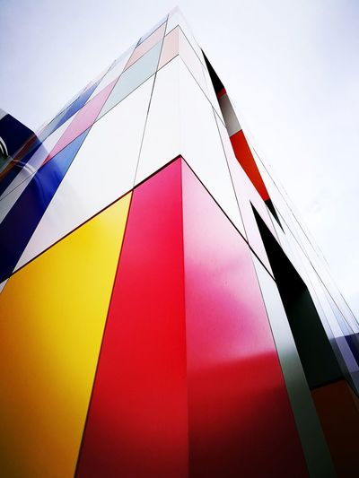 Multi Colored Triangle Shape No People Pink Color Outdoors Low Angle View Sky Day Architecture Exterior Building Detail Textured  Pattern Low Angle View The City Light Minimalist Architecture The Graphic City
