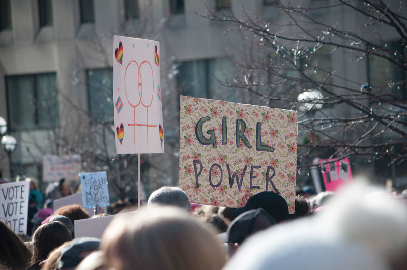 A large crowd gathers for the Women's March in Dayton, Ohio showing their support and their homemade signs. Crowds Dayton, OH Love Protest Sign Signs Architecture City Colorful Communication Crowd Crowd Of People Day March Outdoors People Protest Protestor Real People Trump Women Women's March