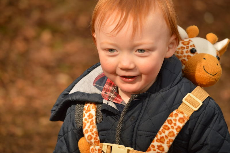 Autumn Leaves Blurred Background Boy Cheerful Child Childhood Exploring Family Giraffe Happiness Oranges And Browns Outdoors Photobomb Red Hair Scotland Smiling EyeEmNewHere Moments Of Happiness