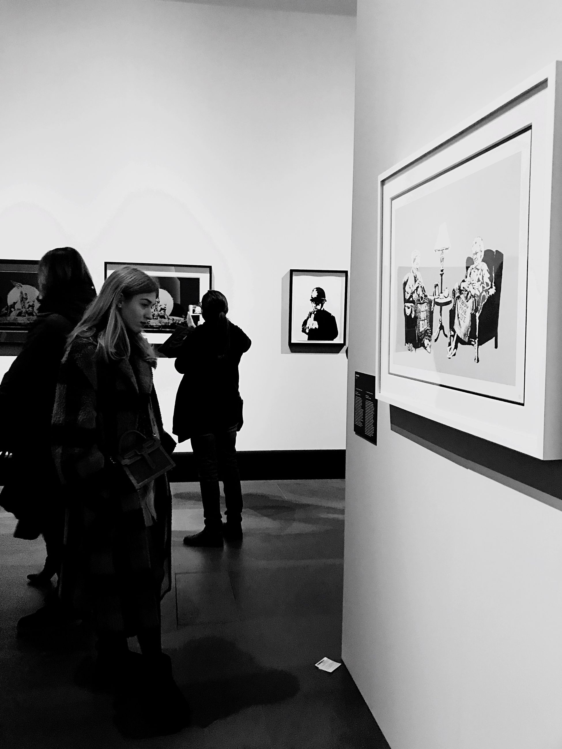 real people, standing, indoors, men, photography themes, technology, lifestyles, frame, picture frame, people, exhibition, clothing, photographing, full length, representation, art museum, leisure activity, human representation, wall - building feature, looking