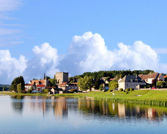 Village of Saint-Sernin-du-Bois, France Saint-Sernin-du-Bois Architecture Beauty In Nature Building Exterior Built Structure Country House Day House Landscape Mountain Nature No People Outdoors Reflection Residential Building River Scenics Sky Town Tree Water Waterfront