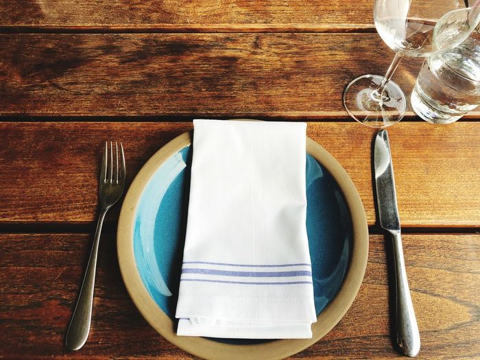 High angle view of place setting on wooden table
